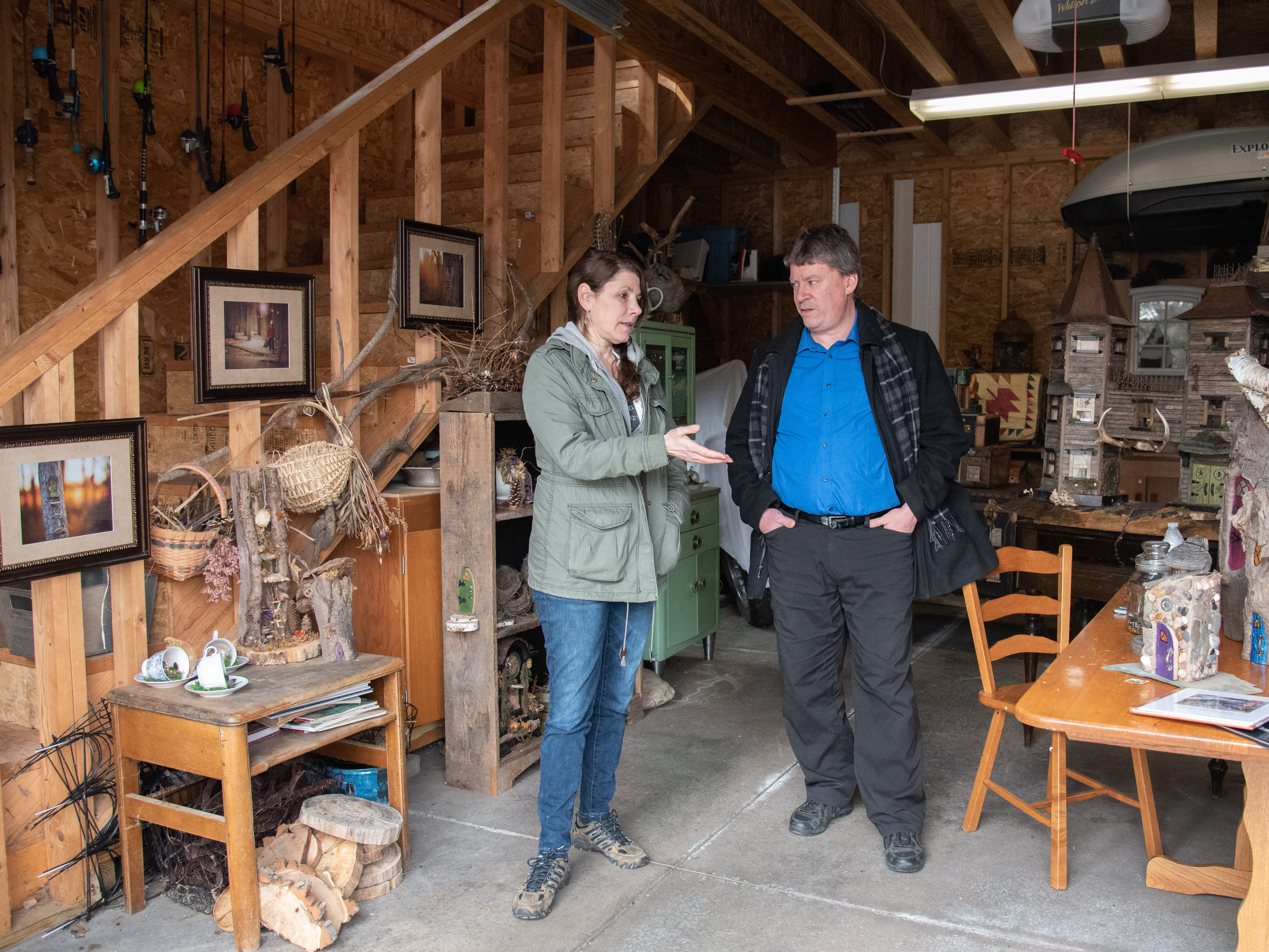 Betsy Marshall, the creator of Tinker Park's miniature fairy houses, talks with Henrietta Town Supervisor Steve Schultz in the workshop at her home in Rush on March 24, 2019.