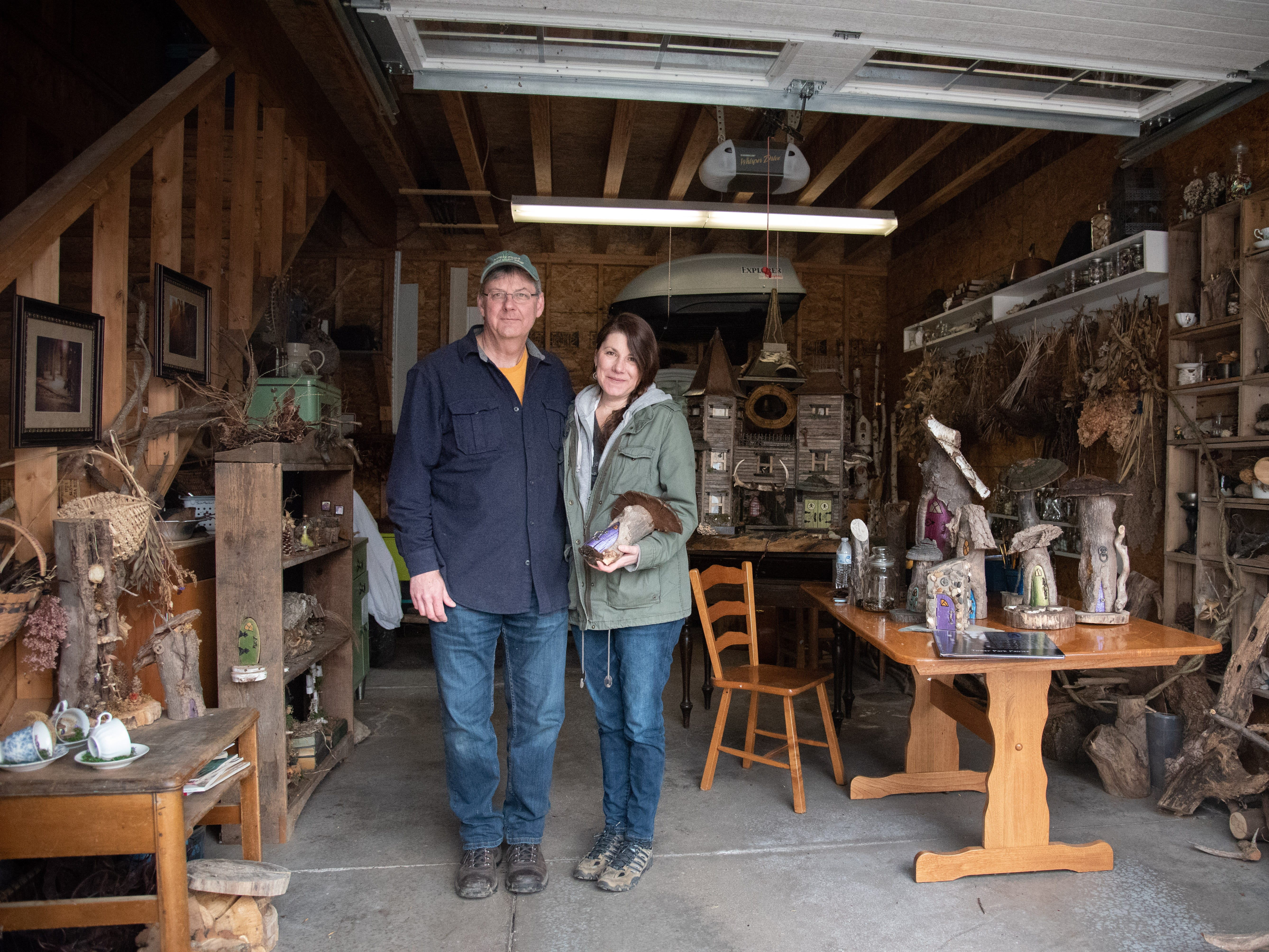 Betsy Marshall and Chris Marshall stand inside their magical garage-turned-workshop at their home in Rush. The two have been creating and maintaining the fairy houses at Tinker Nature Park in Henrietta for five years until they were asked to remove them last week. March 24, 2019.