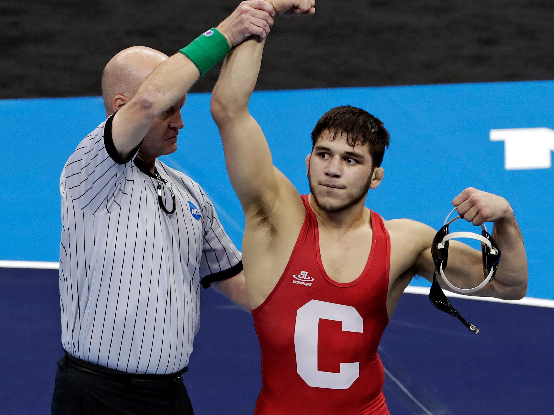 Cornell's Yianni Diakomihalis celebrates his win over Ohio State's Joey McKenna in their 141-pound match in the finals of the NCAA wrestling championships Saturday, March 23, 2019 in Pittsburgh. (AP Photo/Gene J. Puskar)