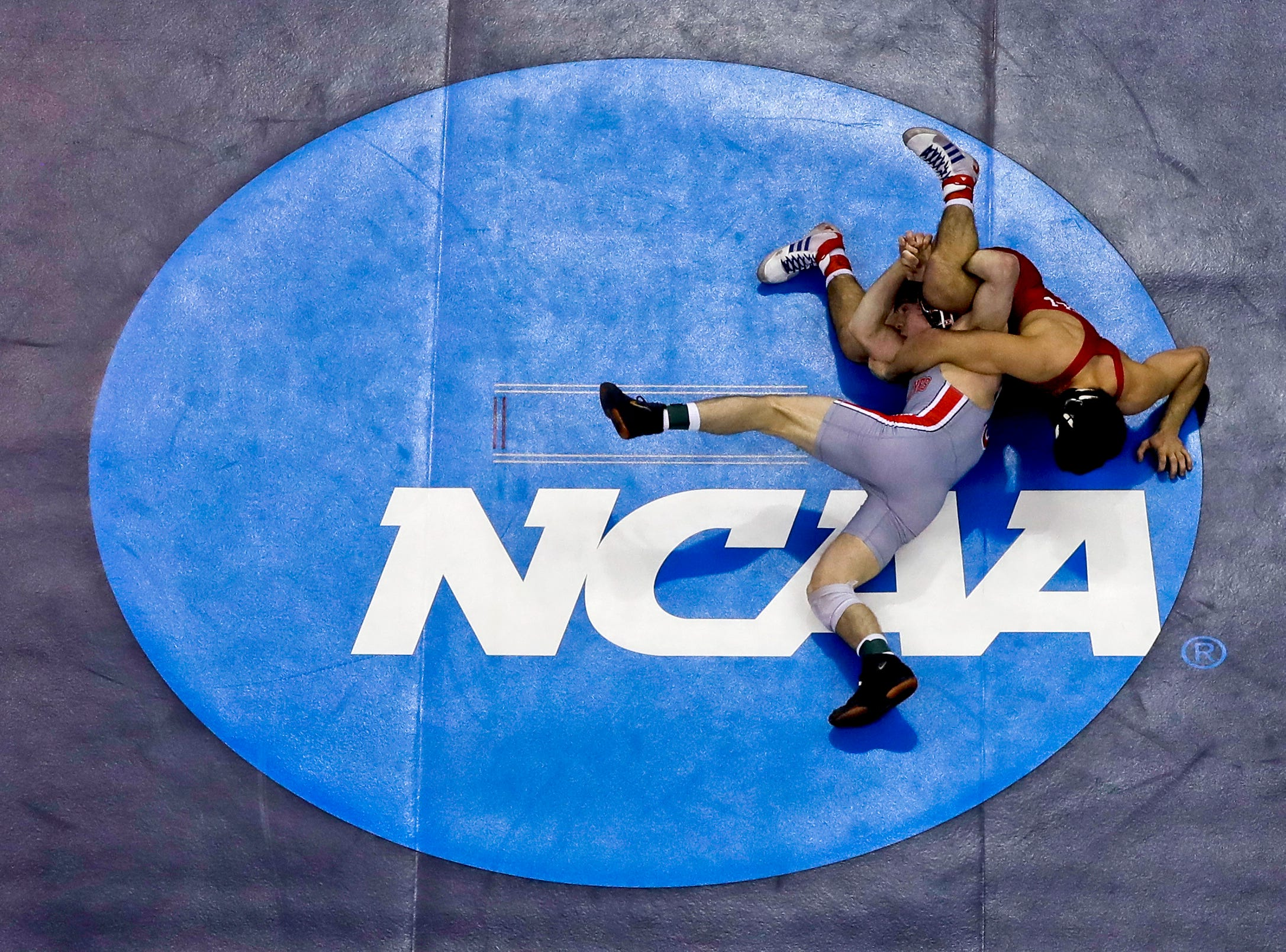Cornell's Yianni Diakomihalis, right, controls Ohio State's Joey McKenna in their 141-pound match in the finals of the NCAA wrestling championships Saturday, March 23, 2019 in Pittsburgh. Diakomihalis won the match.