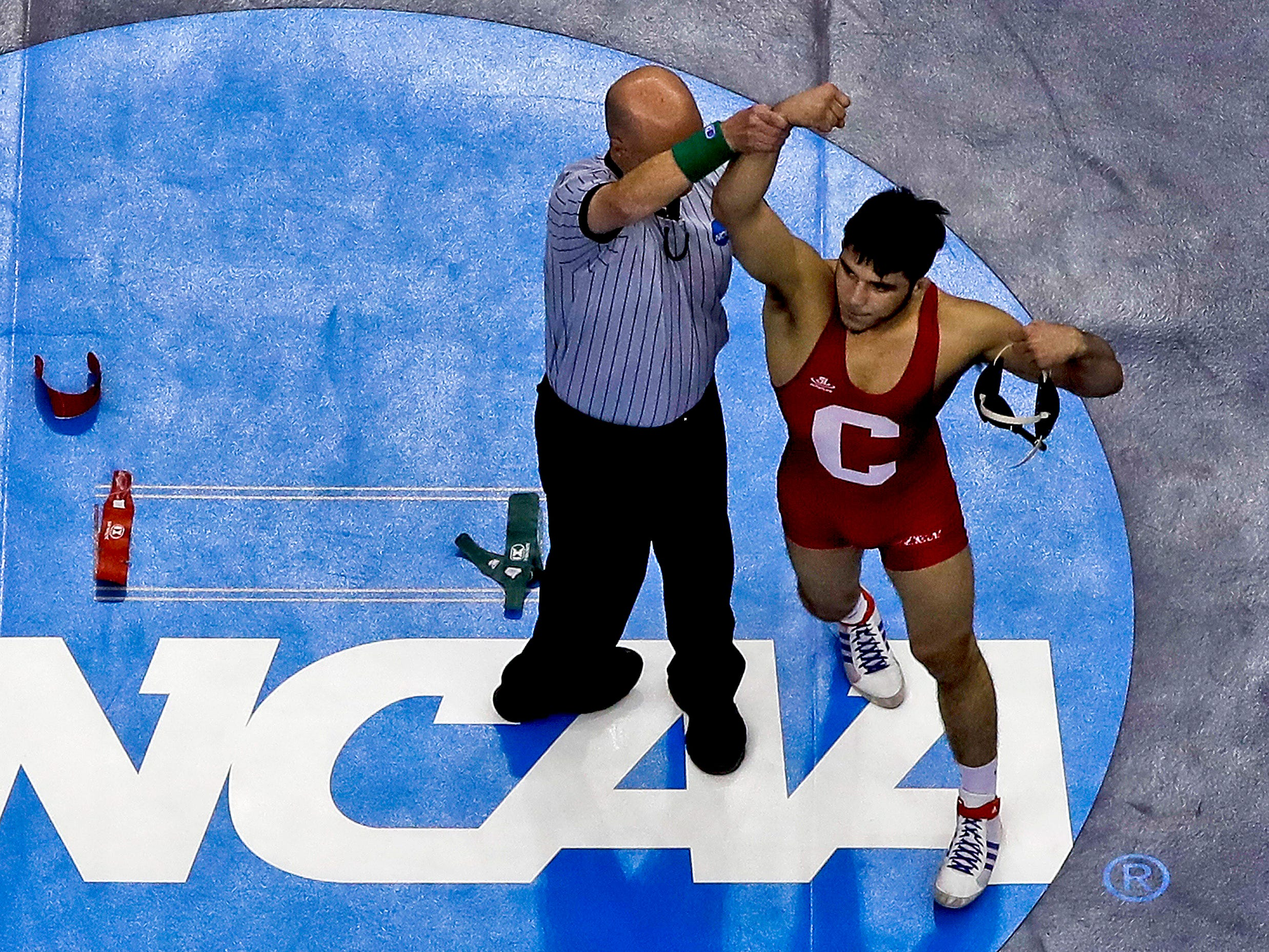 Cornell's Yianni Diakomihalis, right, celebrates his win over Ohio State's Joey McKenna in their 141-pound match in the finals of the NCAA wrestling championships Saturday, March 23, 2019 in Pittsburgh. (AP Photo/Gene J. Puskar)