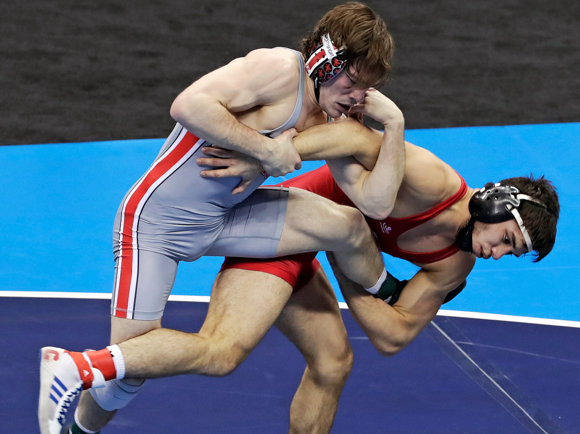 Cornell's Yianni Diakomihalis, right, tries to takedown Ohio State's Joey McKenna in their 141-pound match in the finals of the NCAA wrestling championships Saturday, March 23, 2019 in Pittsburgh. Diakomihalis won the match. (AP Photo/Gene J. Puskar)