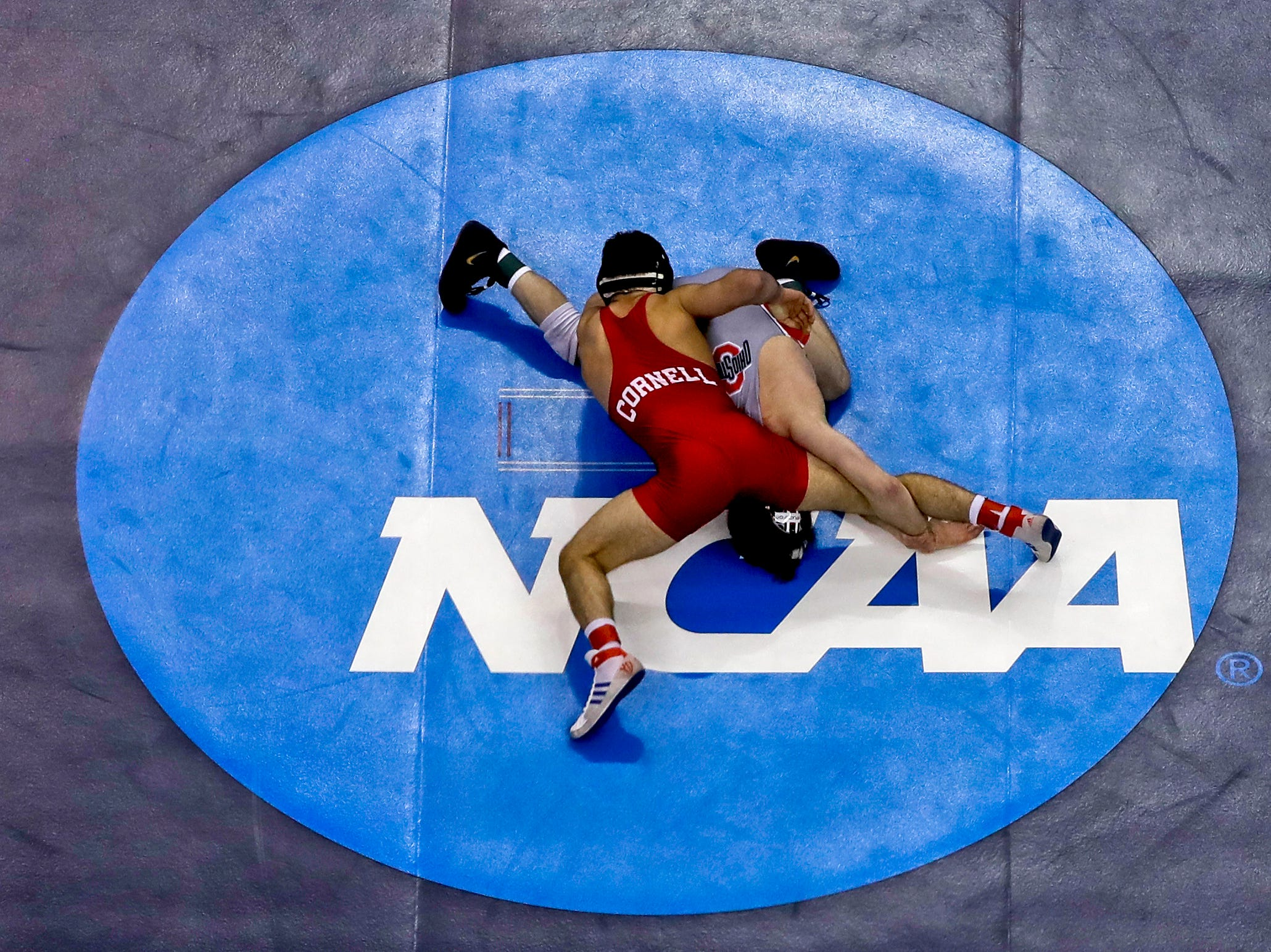 Cornell's Yianni Diakomihalis, top, controls Ohio State's Joey McKenna in their 141-pound match in the finals of the NCAA wrestling championships Saturday, March 23, 2019 in Pittsburgh. Diakomihalis won the match.