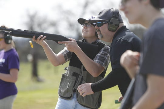High school trap shooters practice at the Redding Gun Club on Sunday, March 24.