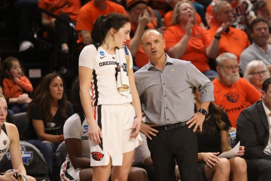 Oregon State head coach Scott Rueck, right, talks with Aleah Goodman (1) during the second half of a first-round game of the NCAA women's college basketball tournament against Boise State in Corvallis, Ore., Saturday, March 23, 2019.