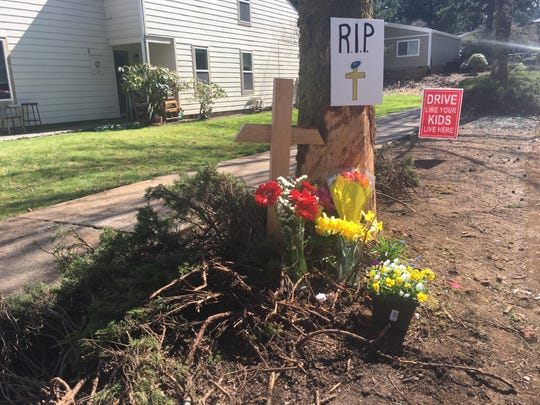 South Salem residents leave flowers in memory of a 17-year-old who died in a car crash around 4 a.m Saturday on the 6600 block of Fairway Avenue SE.