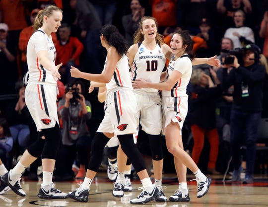 From left to right, Oregon State's Joanna Grymek, Taya Corosdale, Katie McWilliams and Aleah Goodman (1) celebrate their win over Boise State in a first-round game of the NCAA women's college basketball tournament in Corvallis, Ore., Saturday, March 23, 2019.