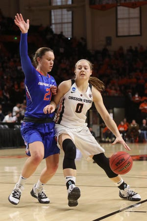 Oregon State's Mikayla Pivec (0) tries to work around Boise State's Riley Lupfer (21) during the first half of a first-round game of the NCAA women's college basketball tournament in Corvallis, Ore., Saturday, March 23, 2019.