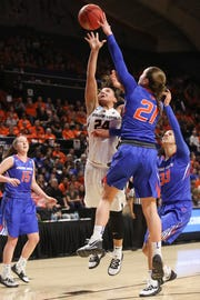 Boise State's Riley Lupfer (21) blocks a shot by Oregon State's Destiny Slocum (24) as Boise State's Joyce Harrell (33) and Tess Amundsen (15) look on during the first half of a first-round game of the NCAA women's college basketball tournament in Corvallis, Ore., Saturday, March 23, 2019.