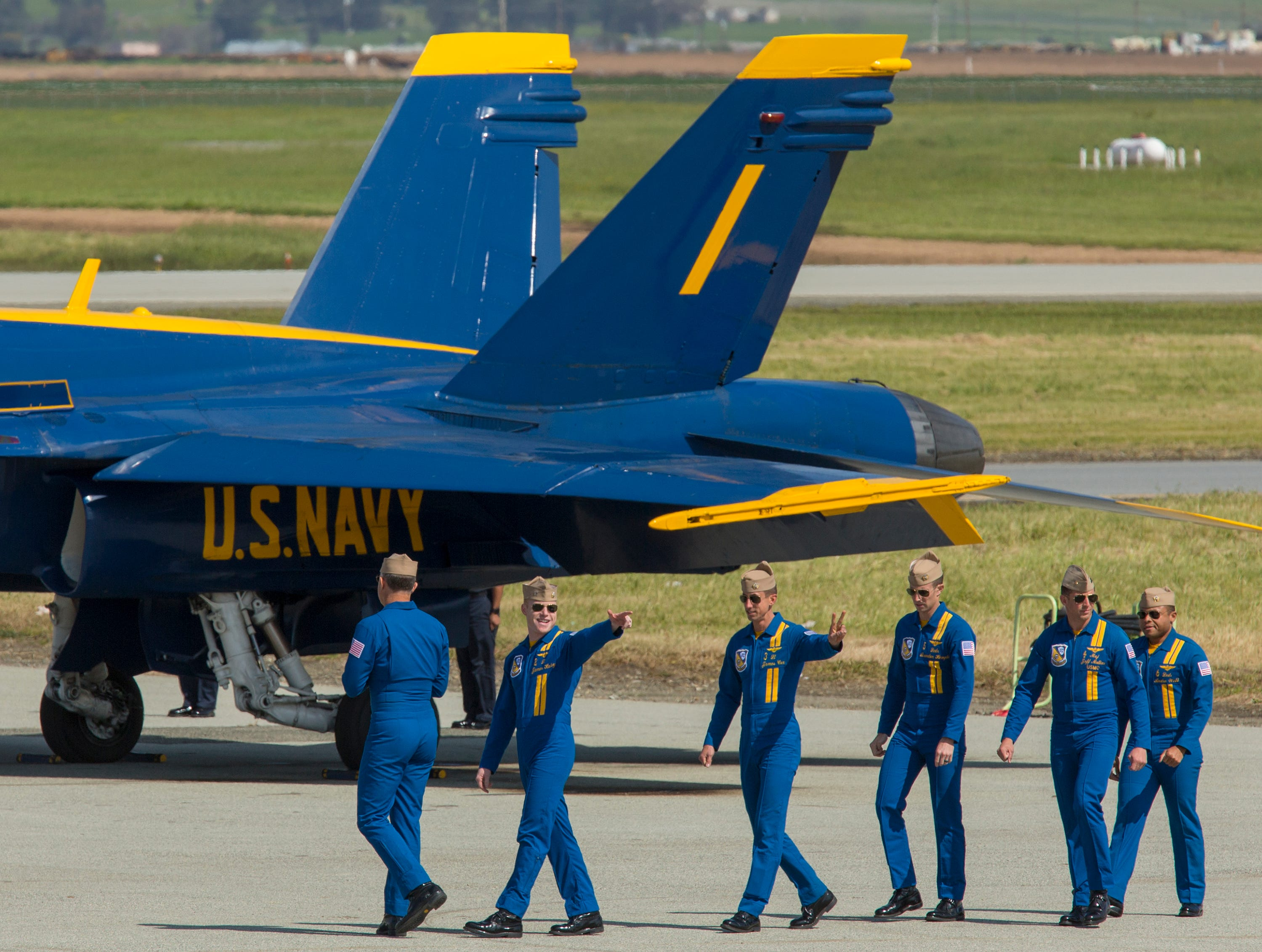 The Blue Angels pilots wave to fans before takeoff during the California International Airshow Salinas at the Salinas Airport on March 23, 2019. (Photo by David Royal)