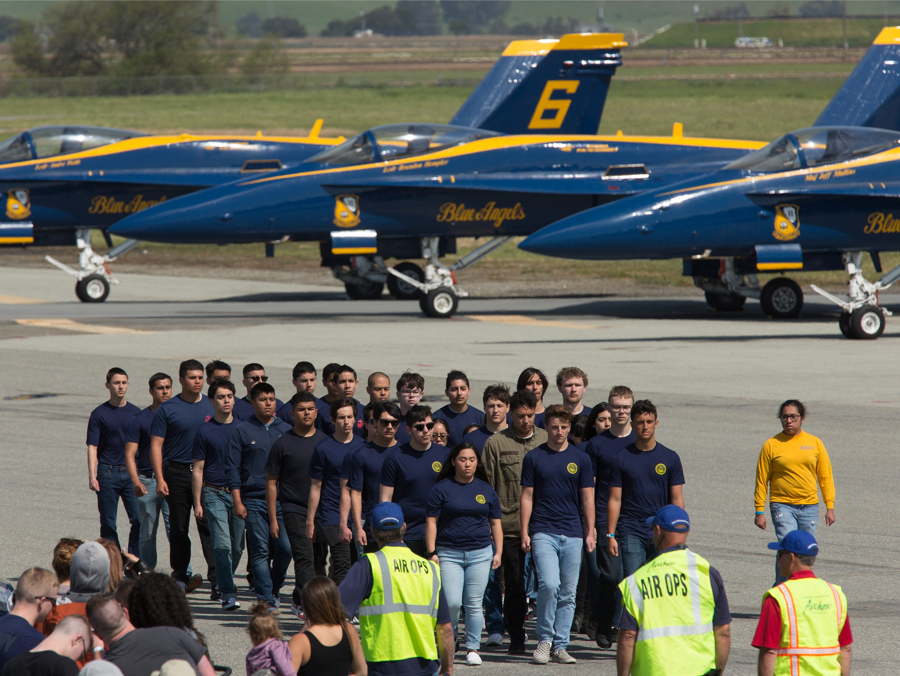 New Navy recruits march past the Blue Angels after taking an oath of enlistment during the California International Airshow Salinas at the Salinas Airport on March 23, 2019. (Photo by David Royal)