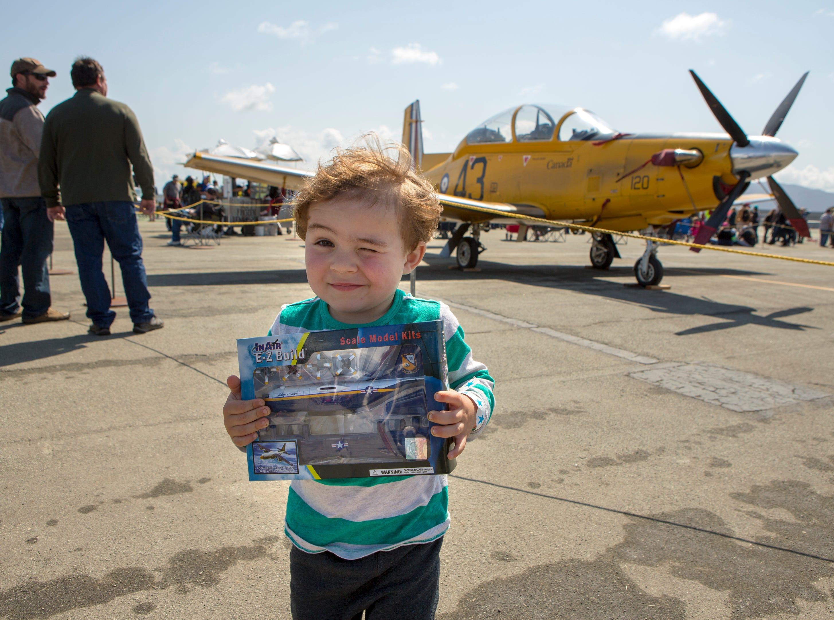 Andersen Hubbard, 3, of Salinas holds a model plane of the Blue Angels Fat Albert C-130 at the California International Airshow Salinas at the Salinas Airport on March 23, 2019. (Photo by David Royal)