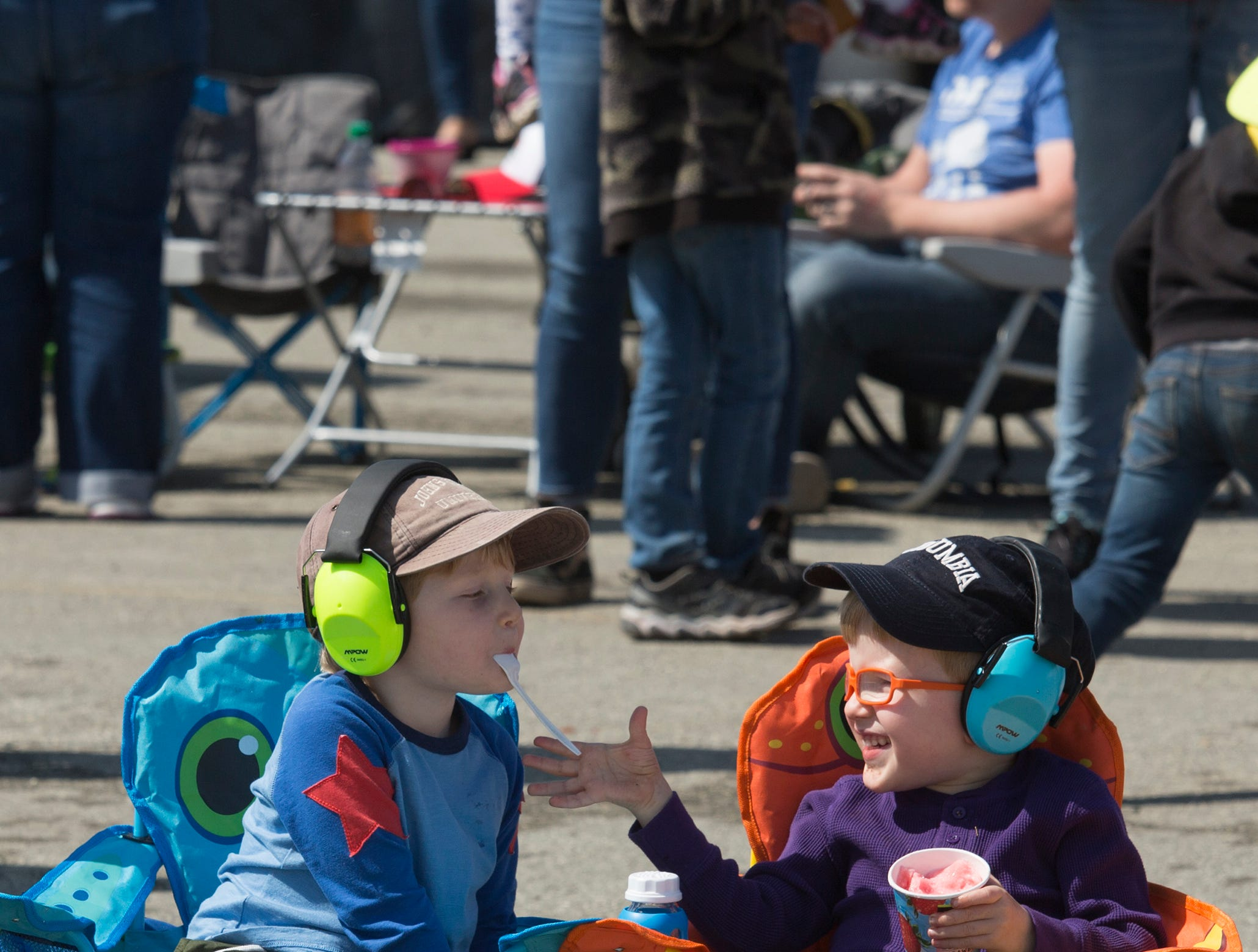 Five-year-old twins Alex and Arthur Ullom snack on frozen lemonade while watching the California International Airshow Salinas at the Salinas Airport on March 23, 2019. (Photo by David Royal)