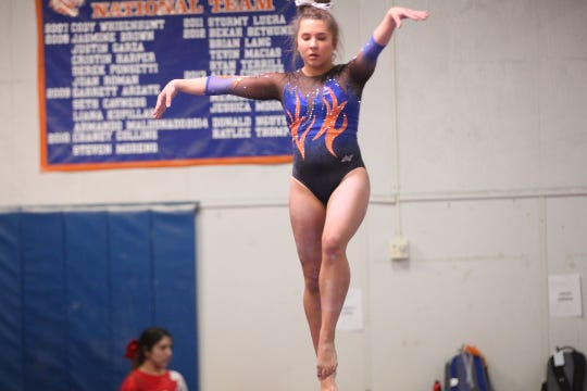 San Angelo Central's Mary Grace Thompson performs on balance beam during Day 2 of the District 2-6A Gymnastics Championships in San Angelo, Saturday, March 23, 2019.
