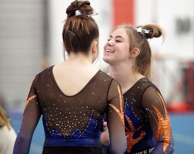 San Angelo Central's Madison Vogel (right) and Jadyn Sawyer share a laugh during Day 2 of the District 2-6A Gymnastics Championships in San Angelo, Saturday, March 23, 2019.