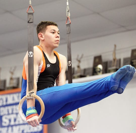 San Angelo Central's Nicolas Hastings competes on still rings during Day 2 of the District 2-6A Gymnastics Championships in San Angelo, Saturday, March 23, 2019.