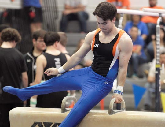 San Angelo Central's Wayne Hines competes on pommel horse during Day 2 of the District 2-6A Gymnastics Championships in San Angelo, Saturday, March 23, 2019.