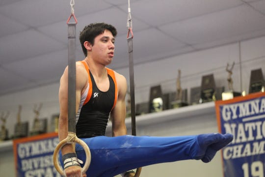 San Angelo Central's Mariano Deller competes on still rings during Day 2 of the District 2-6A Gymnastics Championships in San Angelo, Saturday, March 23, 2019.
