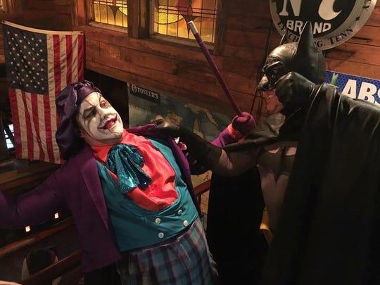 "Eddie Warren, dressed as Jack Nicholson's The Joker, is caught by Michael ""Batman"" Decker."
