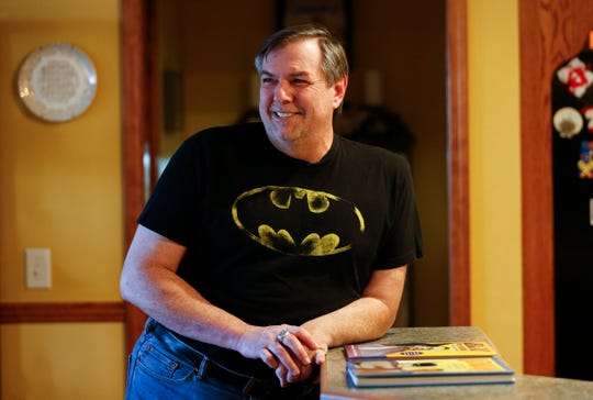 Michael Decker talks about the history of the Batman series at his home on Friday, March 22, 2019.