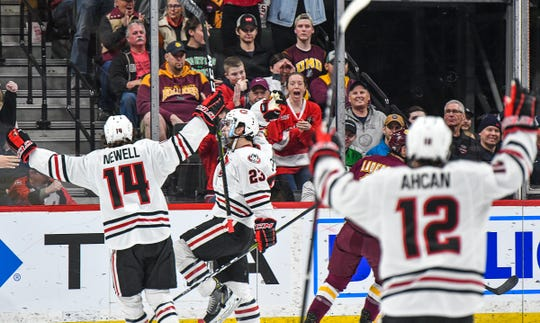 St. Cloud State's Robby Jackson celebrates his goal in the first period during the NCHC Frozen Faceoff championship game against Minnesota-Duluth Saturday, March 23, at the Xcel Energy Center in St. Paul.