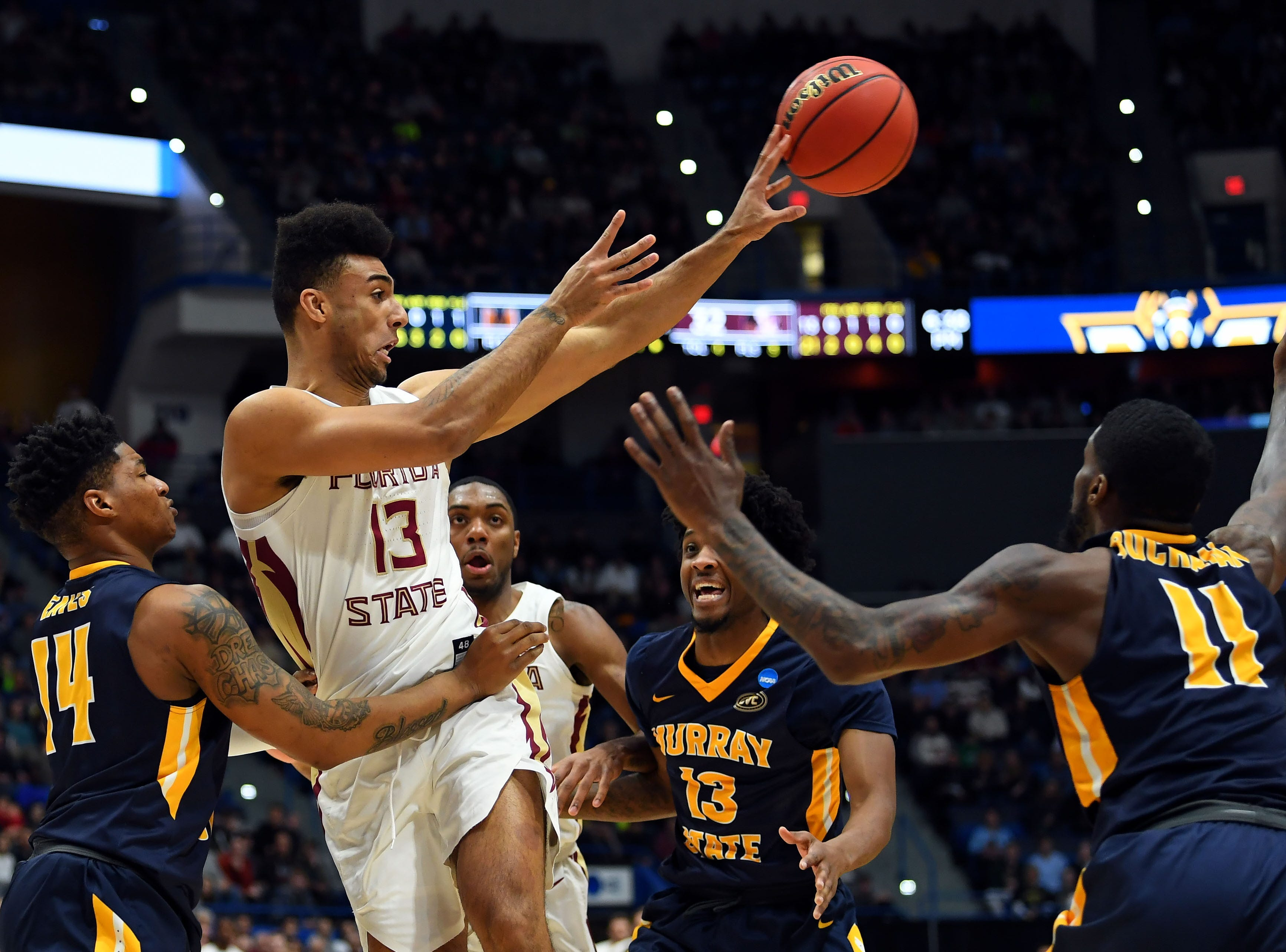 Mar 23, 2019; Hartford, CT, USA; Florida State Seminoles guard Anthony Polite (13) passes the ball against the Murray State Racers during the first half of a game in the second round of the 2019 NCAA Tournament at XL Center. Mandatory Credit: Robert Deutsch-USA TODAY Sports