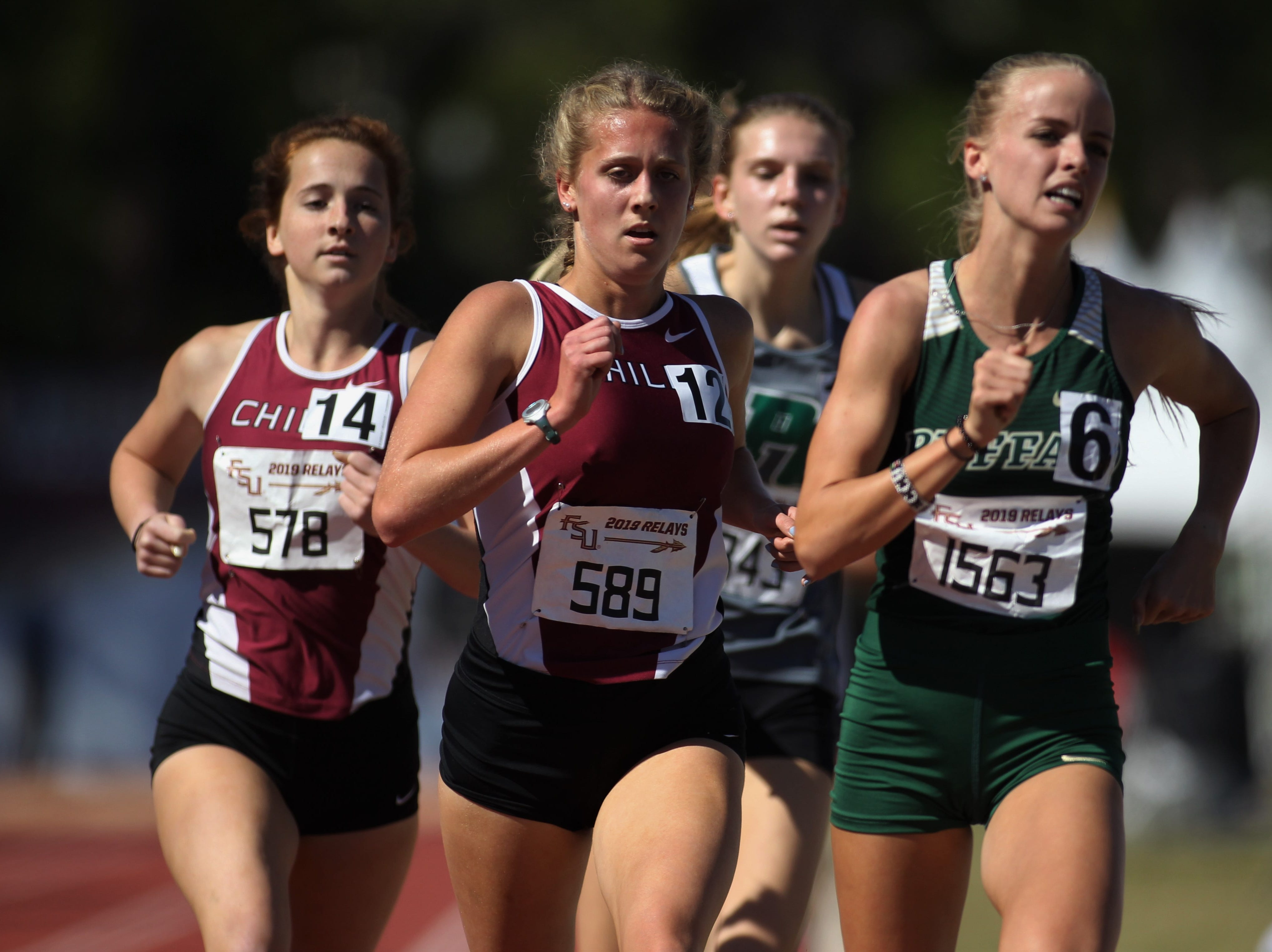 Chiles junior Caitlin Wilkey runs the 1600 Invite ahead of teammate Emily Culley during the 40th annual FSU Relays at Mike Long Track on Saturday, March 23, 2019.