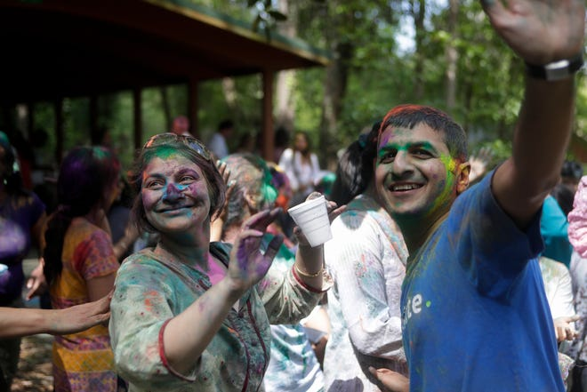 People dance together during a Holi celebration organized by the India Association of Tallahassee at A.J. Henry Park Sunday, March 24, 2019.