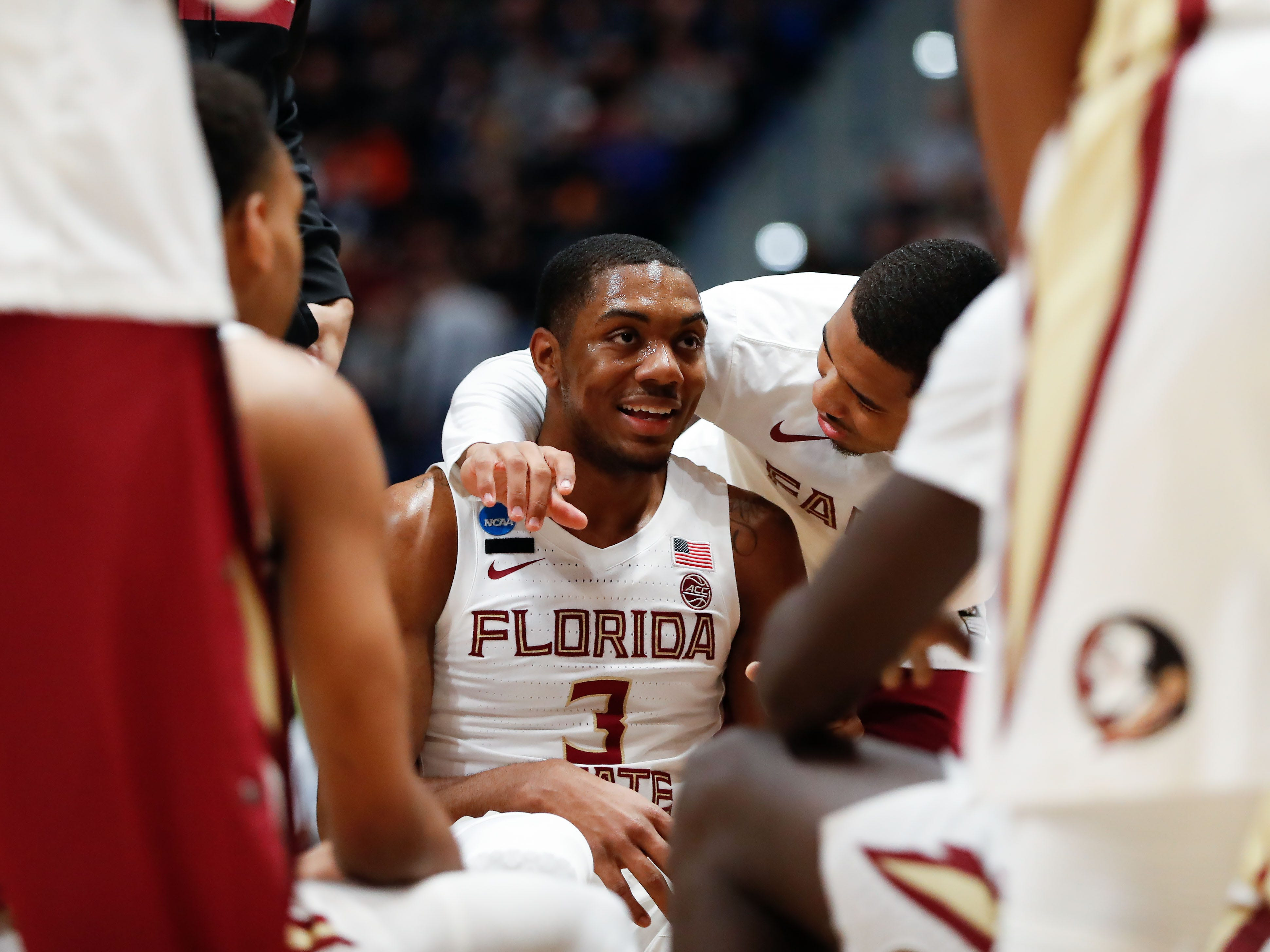 Mar 23, 2019; Hartford, CT, USA; Florida State Seminoles guard Trent Forrest (3) talks with teammates during a time out in the first half of a game against the Murray State Racers in the second round of the 2019 NCAA Tournament at XL Center. Mandatory Credit: David Butler II-USA TODAY Sports