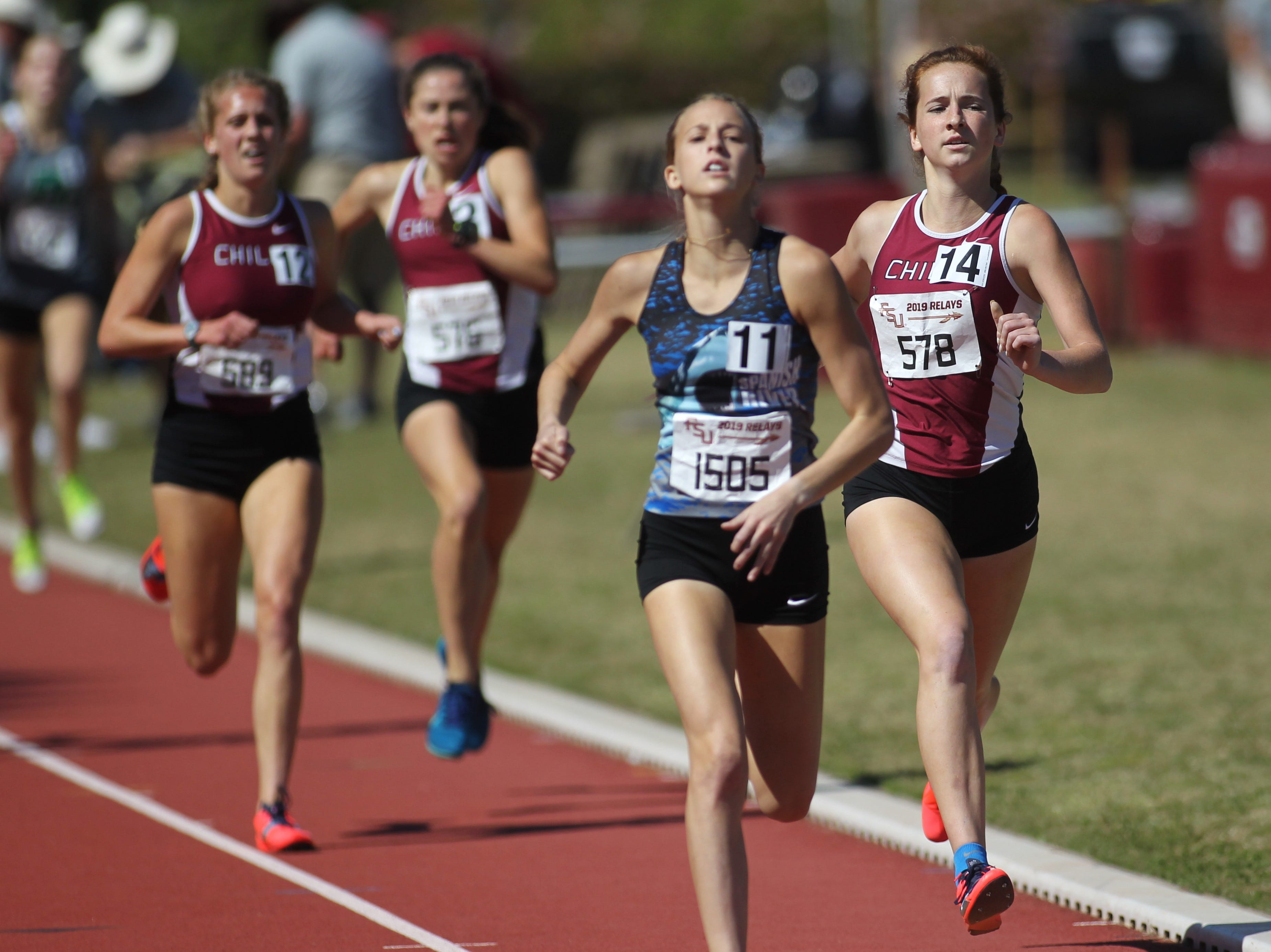 Chiles senior Emily Culley leads teammates Caitlin Wilkey and Alyson Churchill into the finish of the 1600 Invite during the 40th annual FSU Relays at Mike Long Track on Saturday, March 23, 2019. All three ran sub-5:00.
