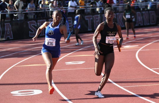 Lincoln's Taryn Henry runs the second leg of the 4x400 next to Godby's A'Kyrah O'Banner during the 40th annual FSU Relays at Mike Long Track on Saturday, March 23, 2019. Lincoln won while setting a new meet and county record.