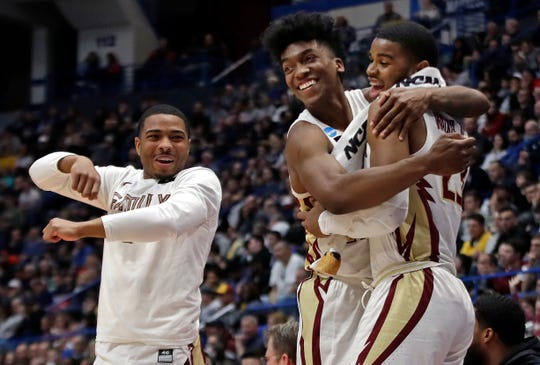 From left, Florida State's David Nichols, Terance Mann and M.J. Walker celebrate at the bench during the second half of a second round men's college basketball game against Murray State in the NCAA Tournament Saturday in Hartford, Conn.