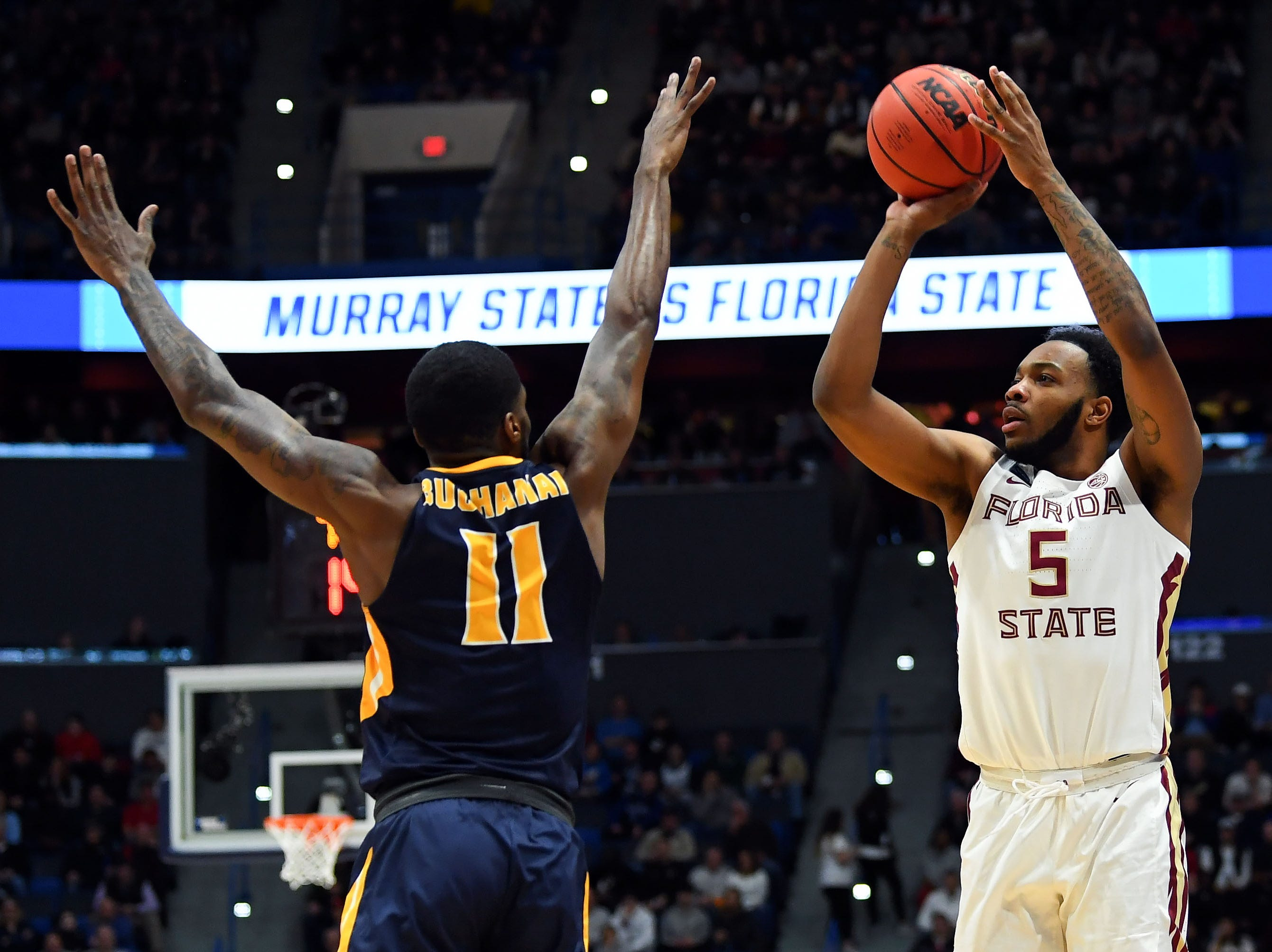 Mar 23, 2019; Hartford, CT, USA; Florida State Seminoles guard PJ Savoy (5) attempt a basket over Murray State Racers guard Shaq Buchanan (11) during the first half of a game in the second round of the 2019 NCAA Tournament at XL Center. Mandatory Credit: Robert Deutsch-USA TODAY Sports