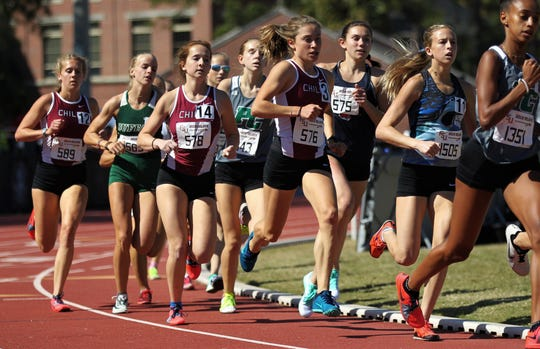Chiles junior Alyson Churchill runs the 1600 invite in a pack ahead of teammates Emily Culley and Caitlin Wilkey during the 40th annual FSU Relays at Mike Long Track on Saturday, March 23, 2019.