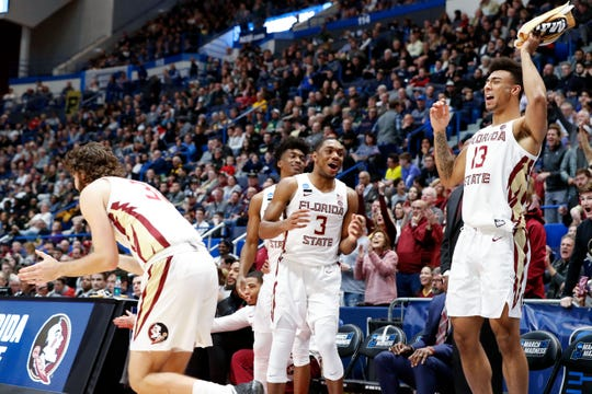 Florida State guard Trent Forrest (3), guard Anthony Polite (13), and guard Wyatt Wilkes (31) react after defeating the Murray State Racers in the second round of the 2019 NCAA Tournament at XL Center.