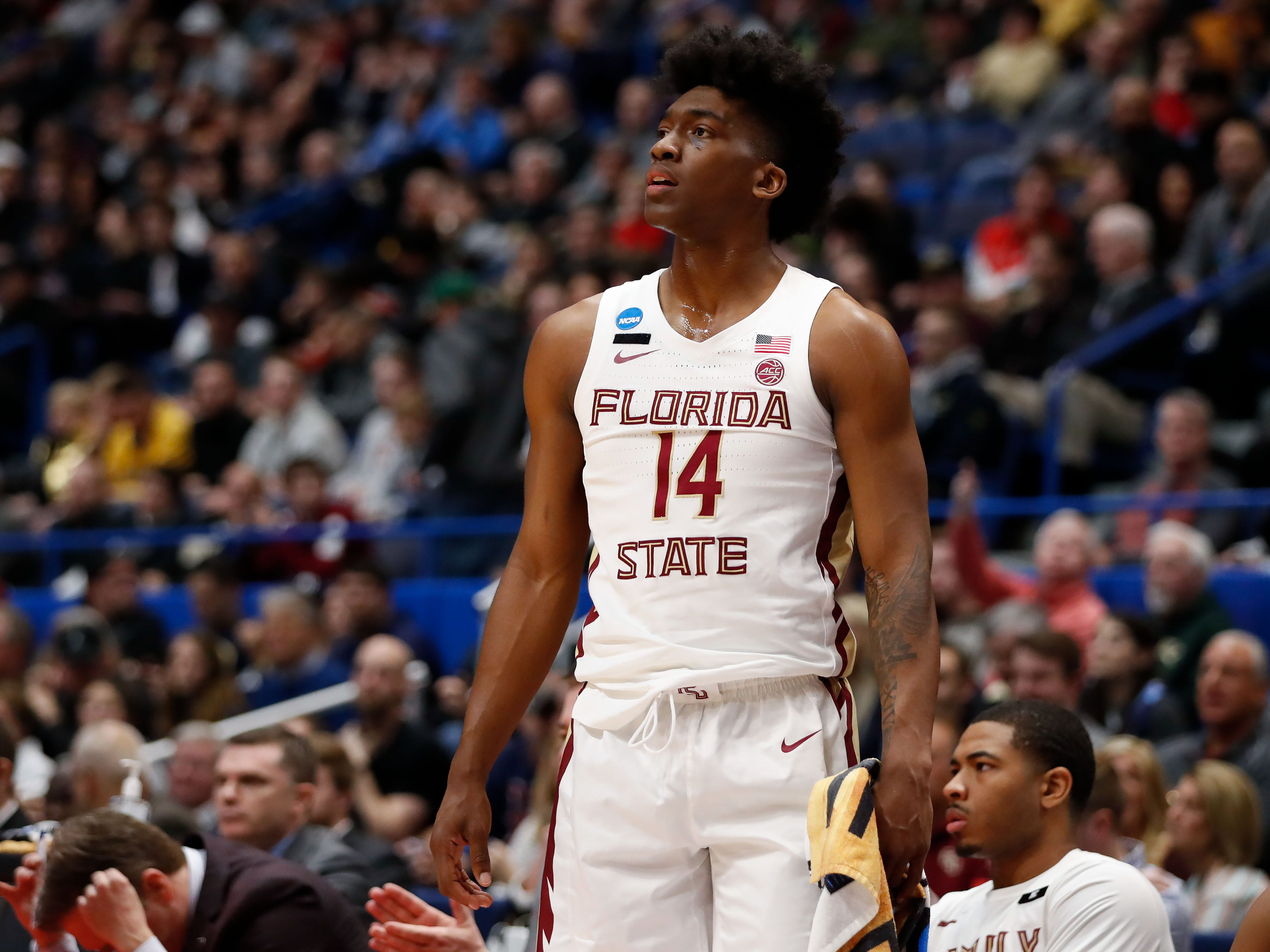 Mar 23, 2019; Hartford, CT, USA; Florida State Seminoles guard Terance Mann (14) watches a play from the bench during the first half of a game against the Murray State Racers in the second round of the 2019 NCAA Tournament at XL Center. Mandatory Credit: David Butler II-USA TODAY Sports
