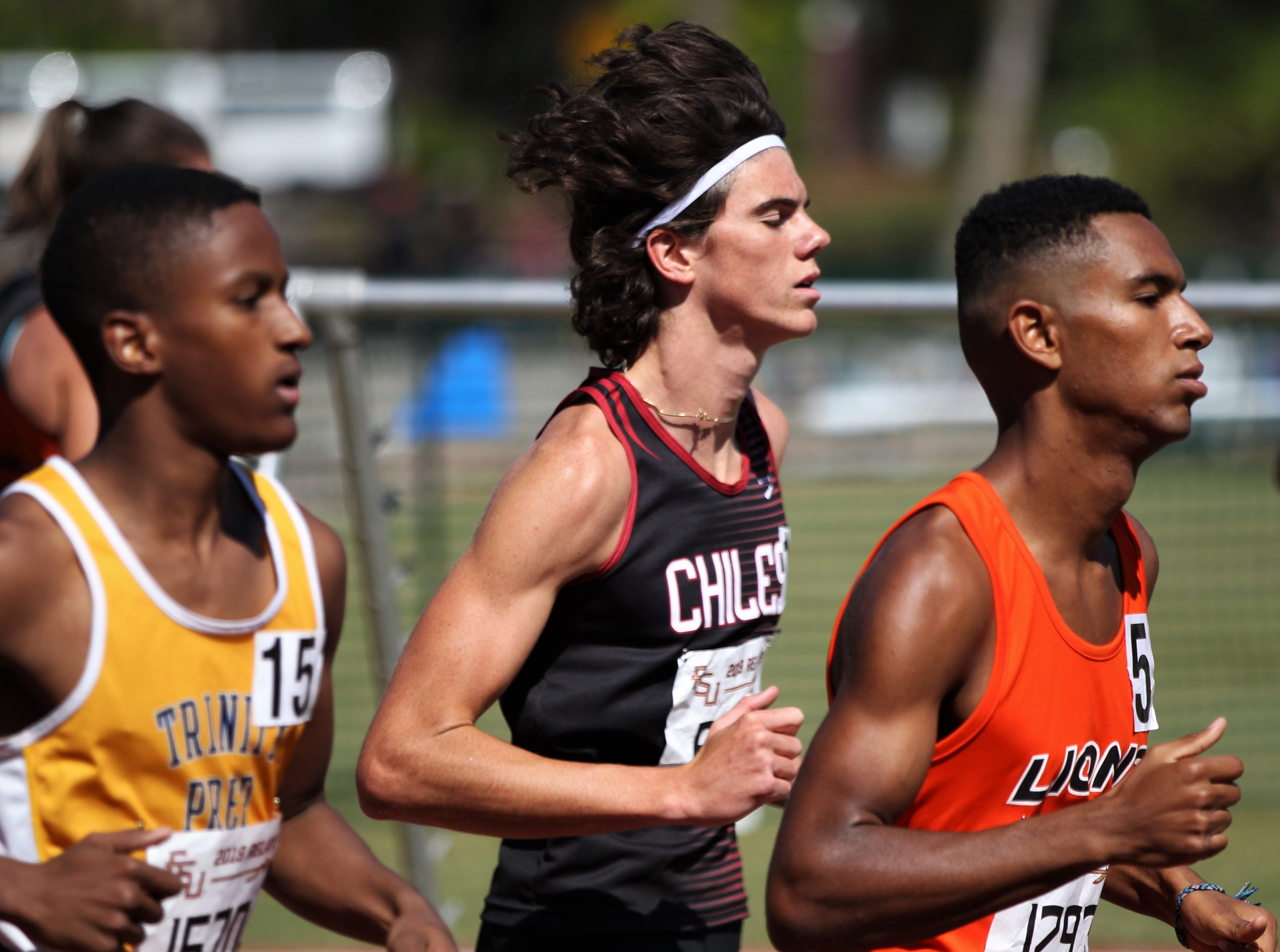 Chiles senior Connor Phillips runs the 1600 Invite during the 40th annual FSU Relays at Mike Long Track on Saturday, March 23, 2019.
