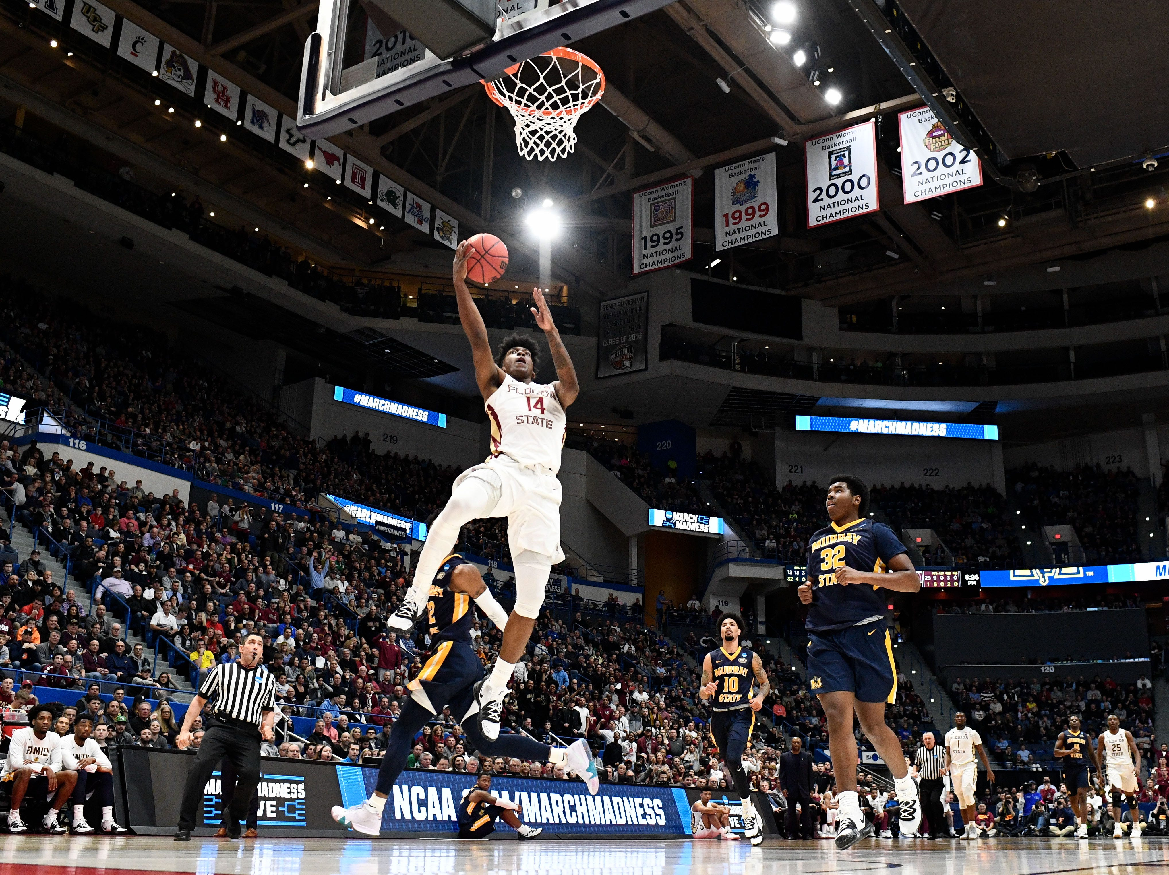 Mar 23, 2019; Hartford, CT, USA; Murray State Racers guard Jaiveon Eaves (14) attempts a layup against the Murray State Racers during the first half of a game in the second round of the 2019 NCAA Tournament at XL Center. Mandatory Credit: Robert Deutsch-USA TODAY Sports