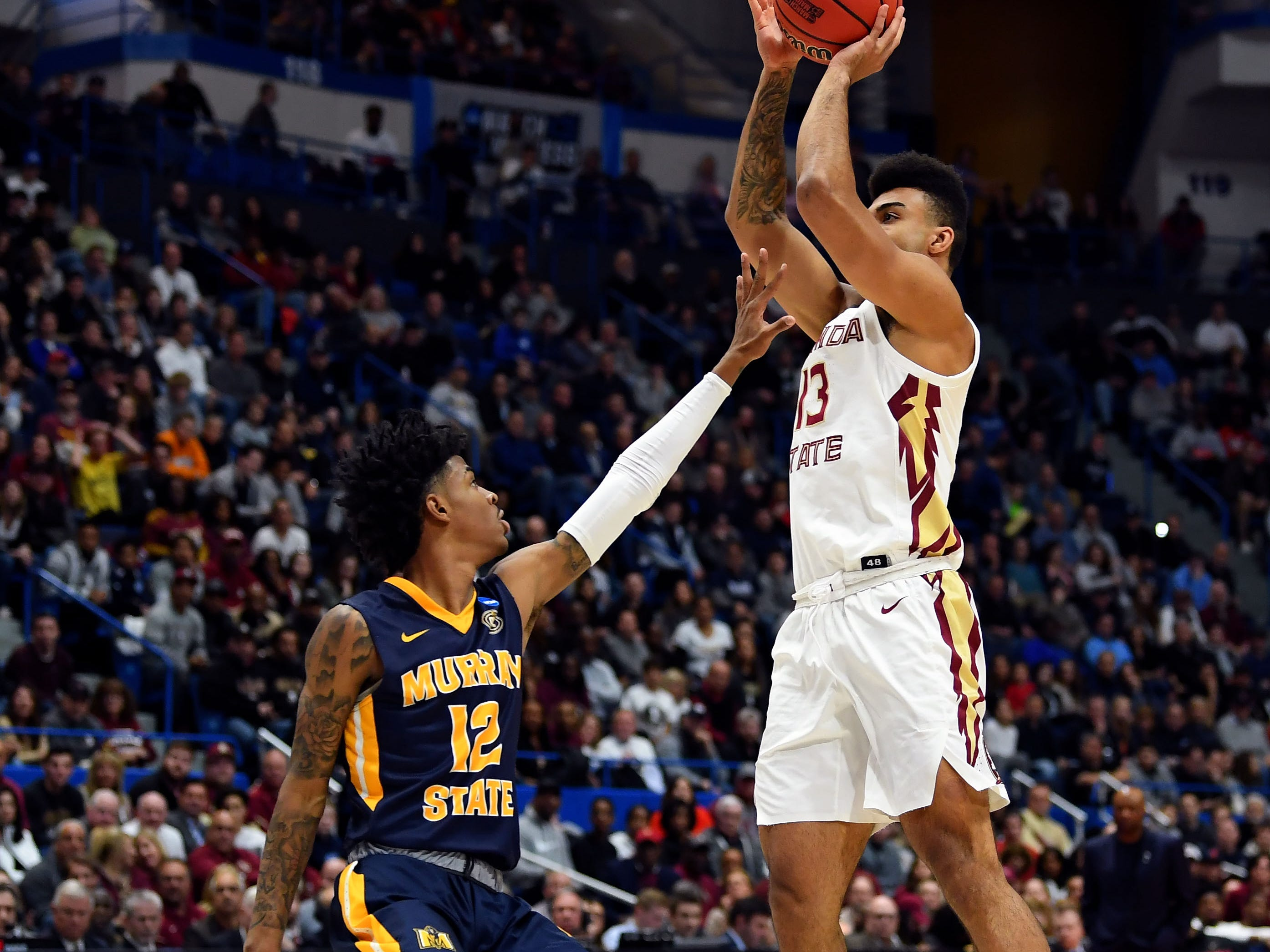 Mar 23, 2019; Hartford, CT, USA; Florida State Seminoles guard Anthony Polite (13) attempts a shot over Murray State Racers guard Ja Morant (12) during the first half of a game in the second round of the 2019 NCAA Tournament at XL Center. Mandatory Credit: Robert Deutsch-USA TODAY Sports