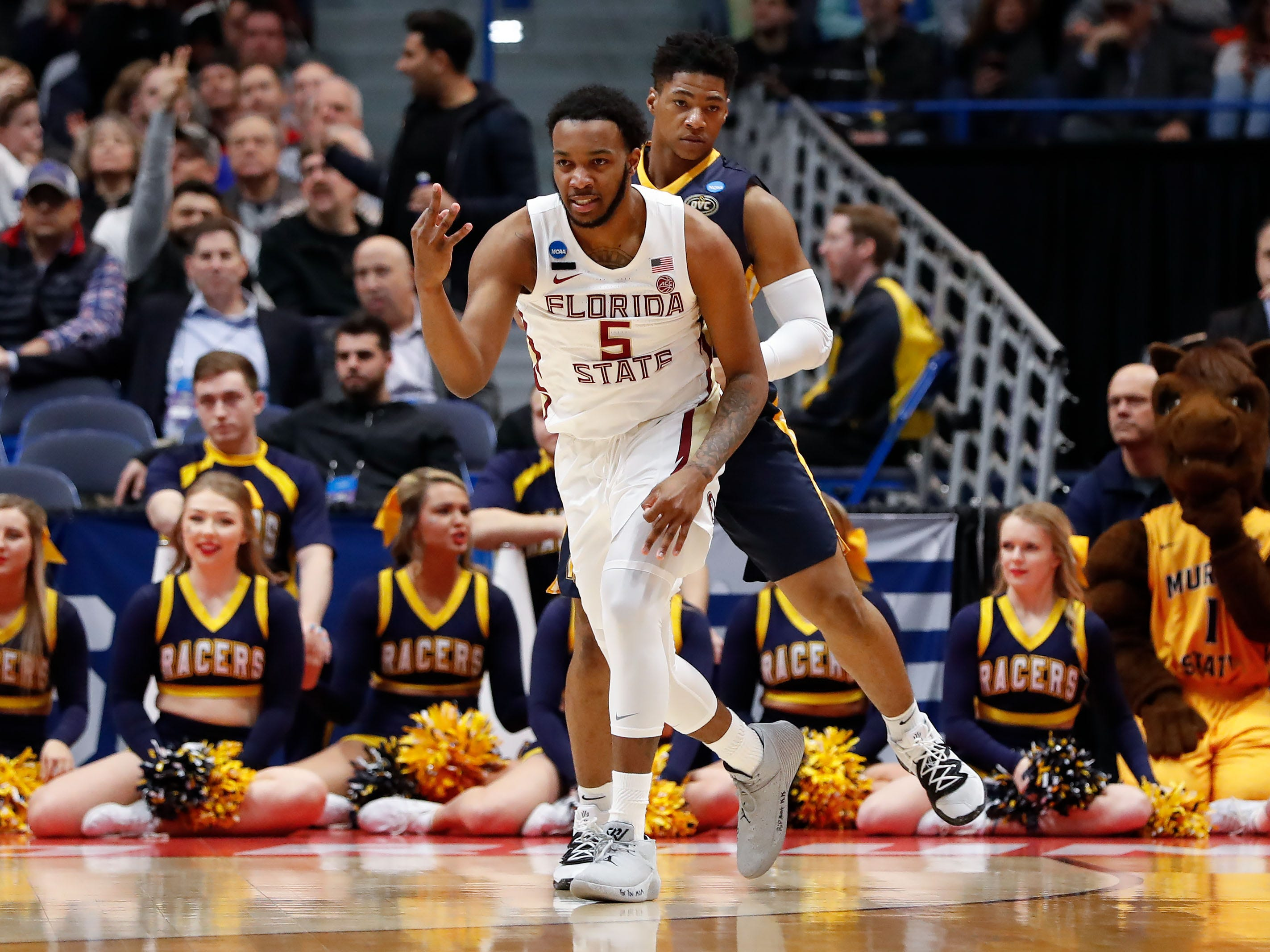 Mar 23, 2019; Hartford, CT, USA; Florida State Seminoles guard PJ Savoy (5) reacts after a score against the Murray State Racers during the first half of a game in the second round of the 2019 NCAA Tournament at XL Center. Mandatory Credit: David Butler II-USA TODAY Sports