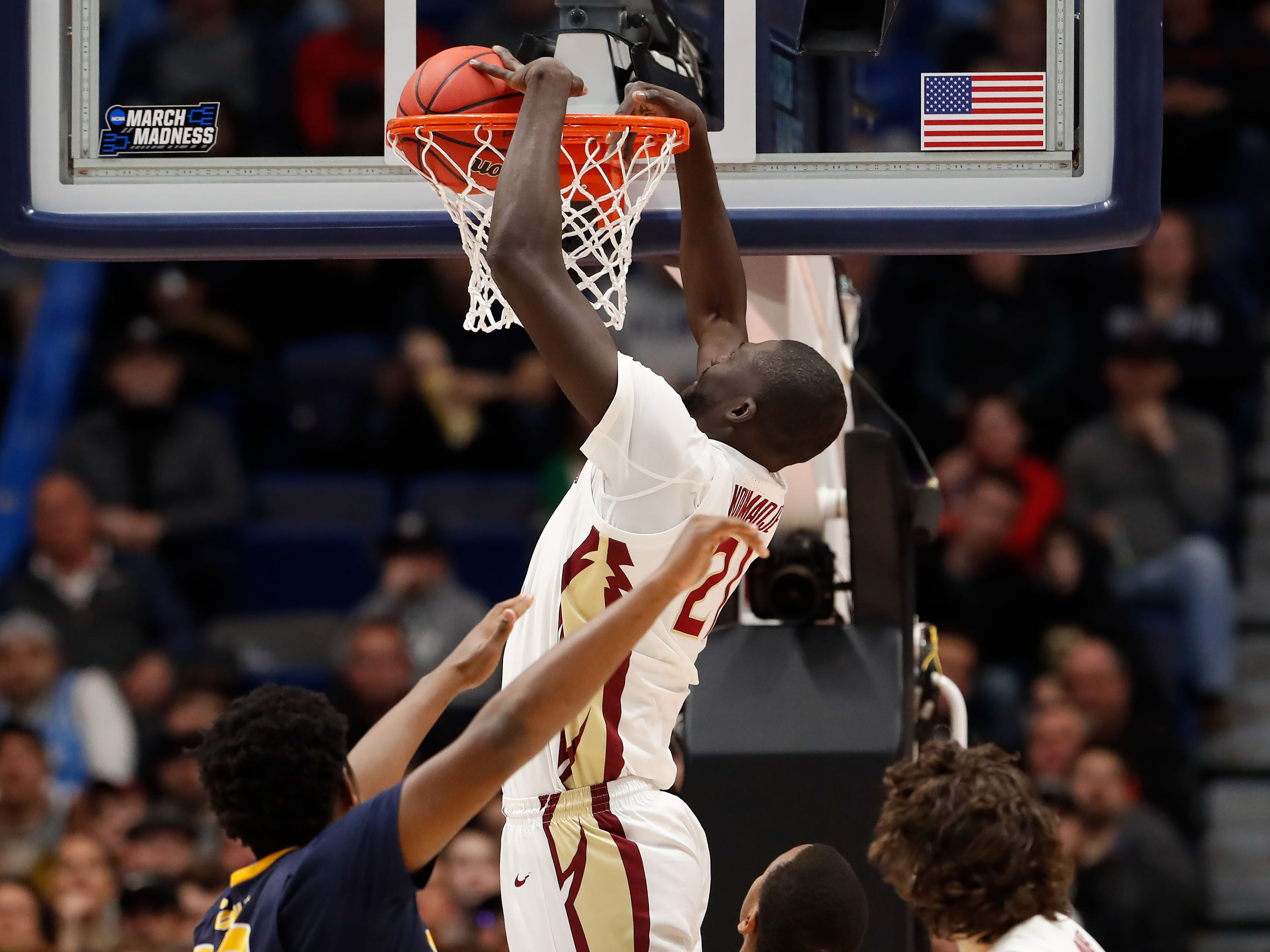 Mar 23, 2019; Hartford, CT, USA; Florida State Seminoles center Christ Koumadje (21) dunks and scores against the Murray State Racers during the first half of a game in the second round of the 2019 NCAA Tournament at XL Center. Mandatory Credit: David Butler II-USA TODAY Sports