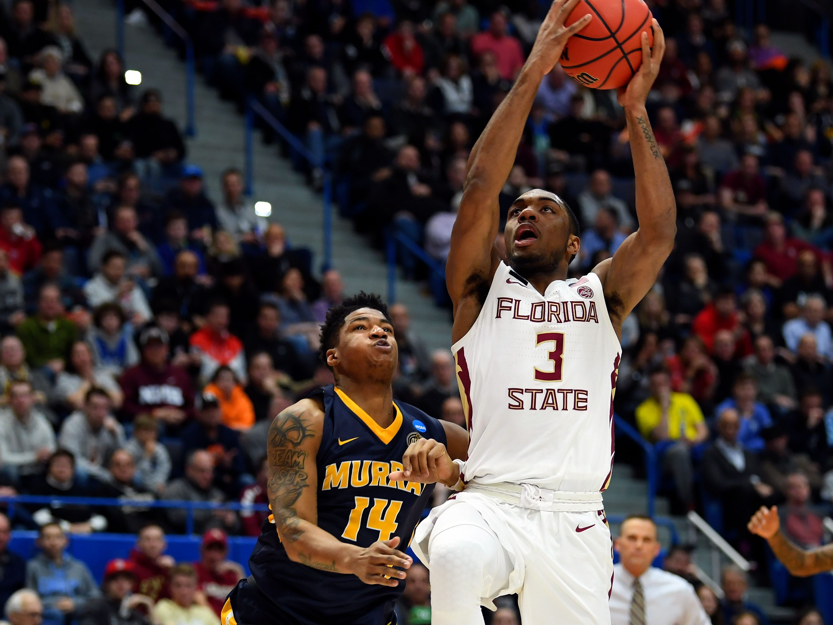 Mar 23, 2019; Hartford, CT, USA; Florida State Seminoles guard Trent Forrest (3) attempts layup against Murray State Racers guard Jaiveon Eaves (14) during the first half of a game in the second round of the 2019 NCAA Tournament at XL Center. Mandatory Credit: Robert Deutsch-USA TODAY Sports