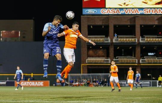 El Paso Locomotive defender Bryam Rebellon jumps for the ball against Rio Grande Valley midfielder Jesus Enriquez.