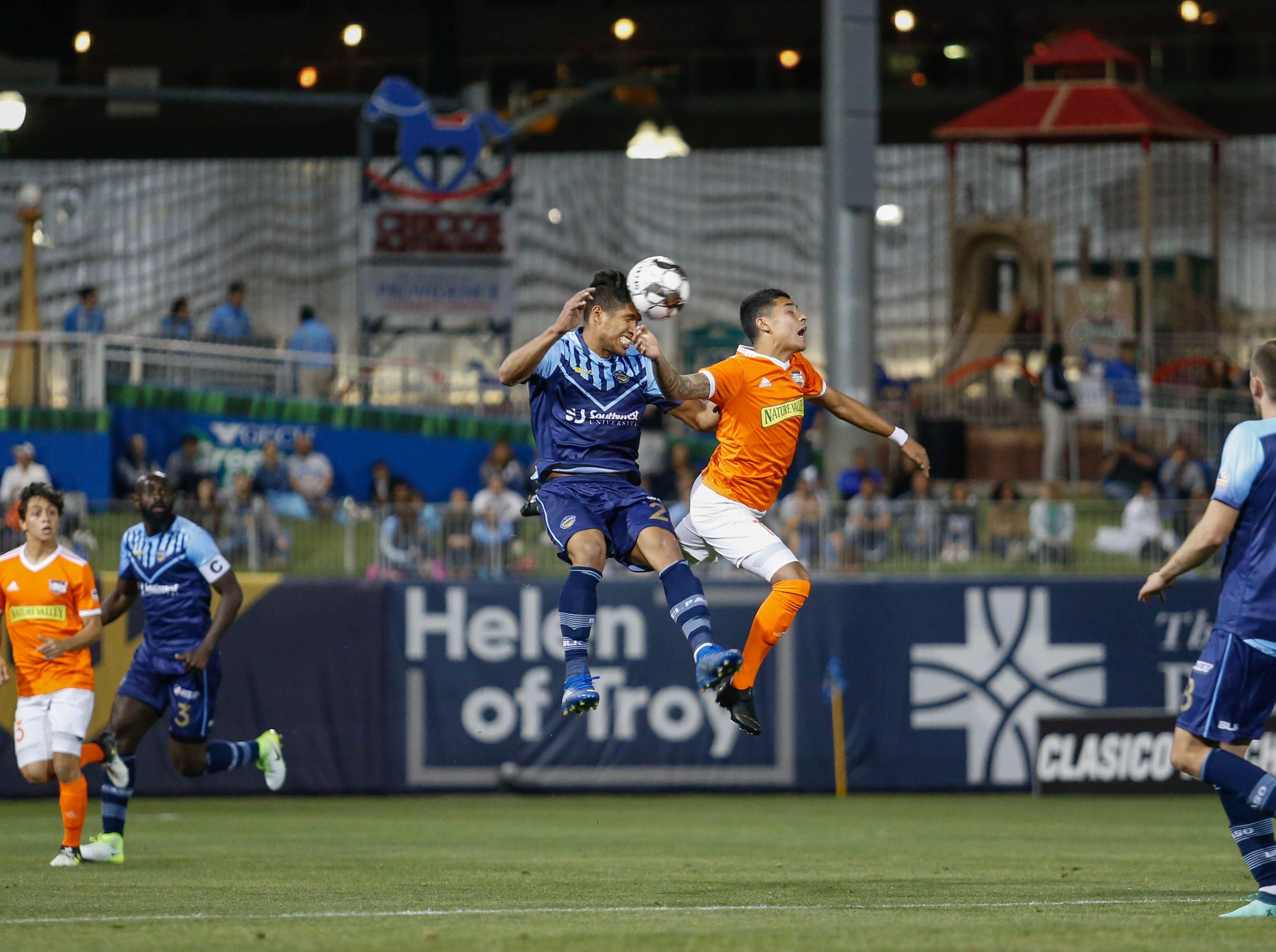 El Paso Locomotive Bryam Rebellon challenges a Rio Grande Valley defender for the ball.