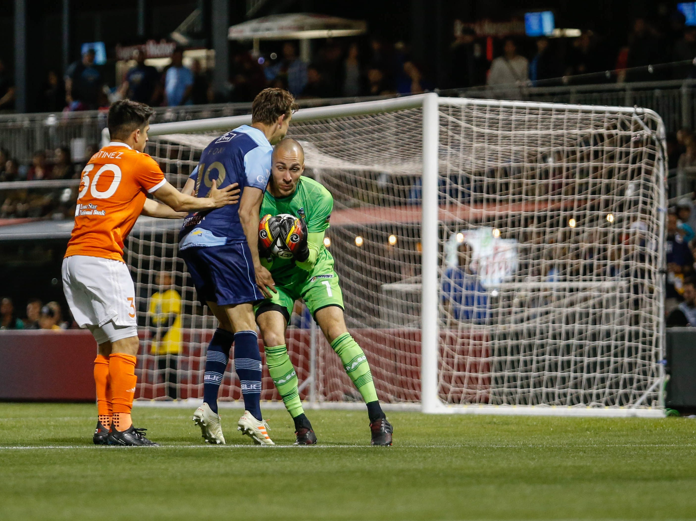 El Paso Locomotive goalkeeper Logan Ketterer grabs the ball before a Rio Grande Valley attacker can take possession of it.