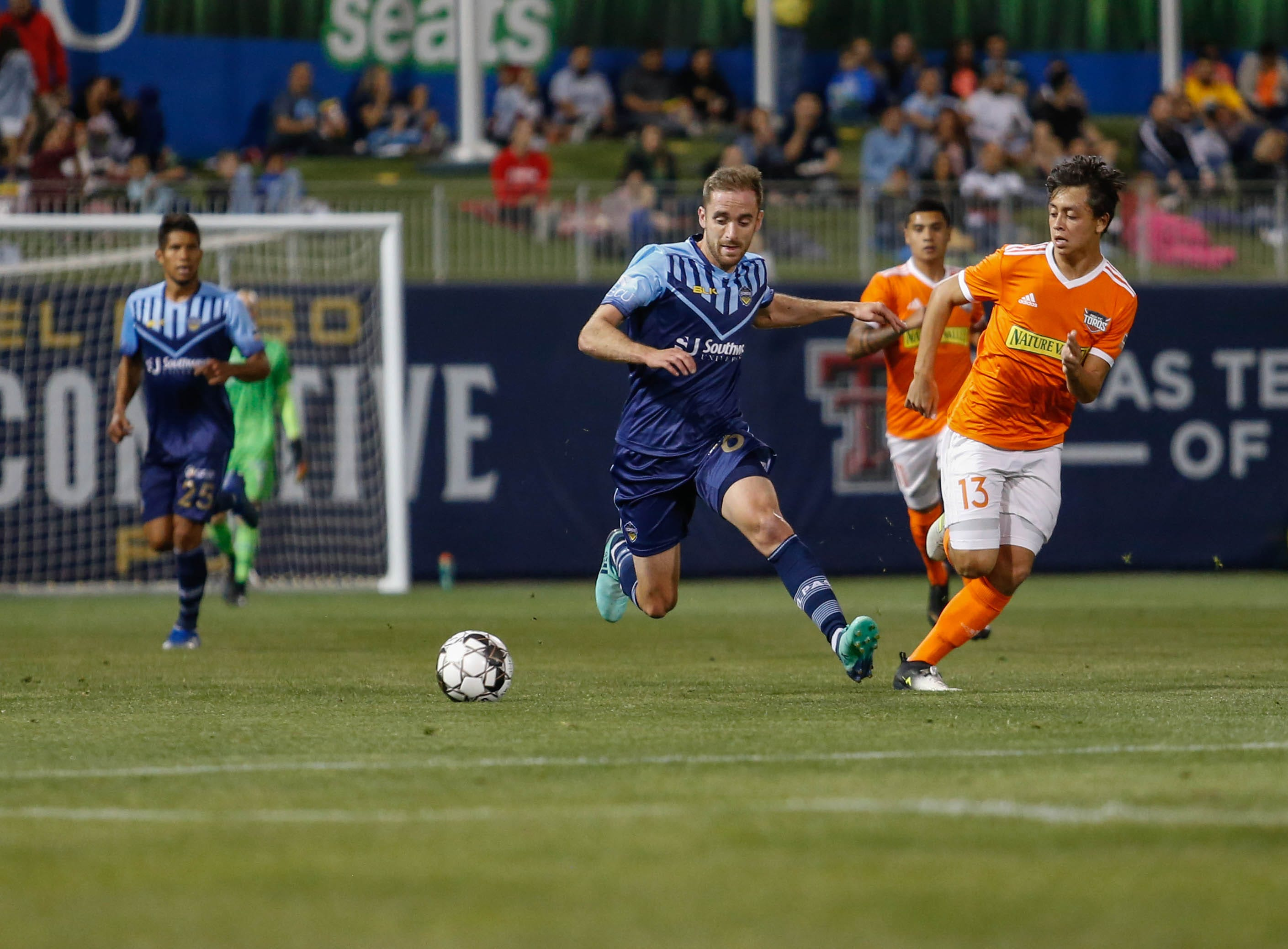El Paso Locomotive midfielder Nick Ross pushes the ball forward in a match against the Rio Grande Valley Toros.