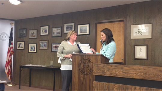 Donna Mazur (left) of the Loyal Order of Moose Lodge 2488 accepts a Making A Difference certificate of appreciation from Millville City Commissioner Ashleigh Udalovas. It was one of three presentations at the commission meeting March 19.