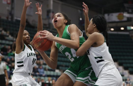 Irvington's Grace Thybulle (24) drives to the basket against Brooklyn Law and Tech during the Class B final of the Federation Tournament at the Cool Insuring Arena in Glens Falls March 24, 2019.