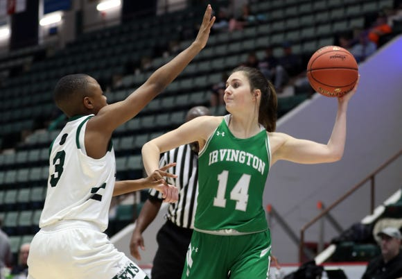 Irvington's Mia Mascone (14) passes to a teammate against Brooklyn Law and Tech during the Class B final of the Federation Tournament at the Cool Insuring Arena in Glens Falls March 24, 2019.