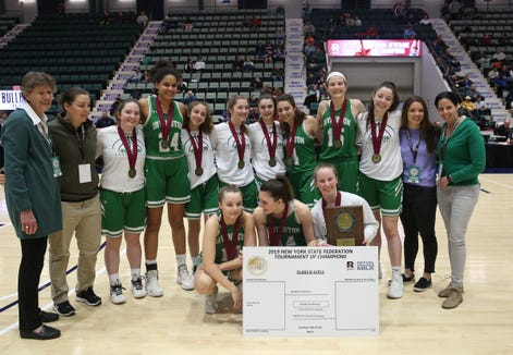 Irvington players pose for a photo after defeating Brooklyn Law and Tech in the Class B final of the Federation Tournament at the Cool Insuring Arena in Glens Falls March 24, 2019.